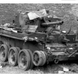 This is John Cloudsley-Thompson's Cromwell. Considering its condition, it is remarkable that all five members of the crew survived. Much of the debris piled on the machine is the result of looting by German soldiers who investigated every hold and box.