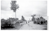 British tanks captured on the highway at Point 213. The Germans are busy examining their new prizes.