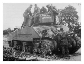 "Geerman troops inspect the abandoned hulk of the Sherman Firefly""Alla Kafeek."""