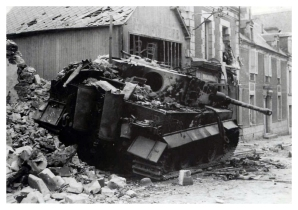 A Tiger lies destroyed in Villers-Bocage in the wake of the afternoon attack.
