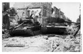 Sgt-Major. Dobrowski's destroyed Panzer IV sits aside First Sgt. Ernst's smashed Tiger.