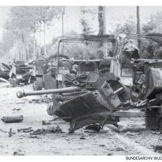 The remains of the Rifle Brigade's 6-pounder section as seen from Villers-Bocage. The riflemen received much criticism for parking their vehicles so closely together. In reality there was a healthy distance between each machine.