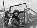 "Captain Davis Perron of the 363rd Squadron, 357th Fighter Group holds the squadron dog, Jack, while sitting in the cockpit of his P-51B Mustang ""Little Bitch"" (#43-6792). Perron was killed in action in January 1944. (Roger Freeman Collection FRE473)"