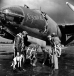 "A bomber crew of the 322nd Bomb Group prepares to board their B-26 Marauder ""Jezabelle,"" with their pet dog ""Salvo."" (Roger Freeman Collection FRE1184)"