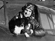 Colonel Robert Landry, the commander of the 56th Fighter Group, poses with his dog. (Roger Freeman Collection FRE2731)