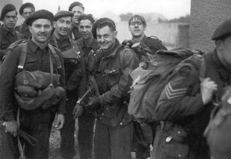 British commandos congregate at the ruins of a holiday camp at Ouisterham, after clearing the area of German troops on the morning of D-Day.