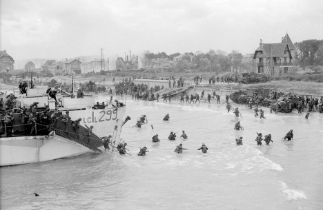"Men of the Stormont, Dundas and Glengarry Highlanders Regiment come ashore from LCI 299 (Landing Craft, Infantry) at Bernieres-sur-Mer (""Nan White"" Beach) at 11.40 am. (Reuters; Photo taken by Lt. Gilbert Milne)"